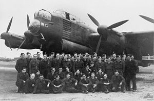 RAF Binbrook - RAAF ground crew posing with the Lancaster bomber G for George in 1944