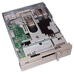 A user inserts the floppy disk, medium opening first, into a 5¼-inch floppy disk drive (pictured, an internal model) and moves the lever down (by twisting on this model) to close the drive and engage the motor and heads with the disk.