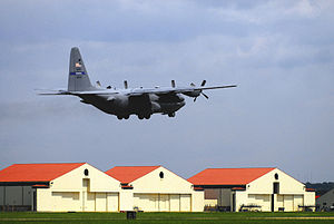 908th Airlift Wing - A wing C-130 Hercules takes off from Maxwell AFB with the wing's hangars in the background