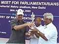 A Member of Parliament receives the First Prize for three legged race from the Union Minister for Parliamentary Affairs, Urban Development Shri Ghulam Nabi Azad at the Sports meet for Parliamentarians and Media Persons.jpg