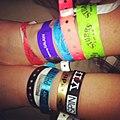 A SXSW's worth of wristbands (8739517638).jpg