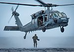 A Sailor jumps from an MH-60 Sea Hawk helicopter off the coast of Guam. (33743737923).jpg