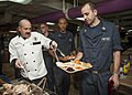 A Sailor serves a Thanksgiving meal. (15736996430).jpg