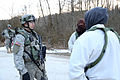 A U.S. Army first lieutenant, front left, with Apache Troop, 3rd Squadron, 2nd Cavalry Regiment talks to civilian role players during a mission rehearsal exercise at the Joint Multinational Readiness Center 130308-A-RA799-101.jpg