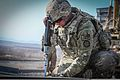 A U.S. Soldier with the 1438th Engineer Company, Missouri Army National Guard bolts a bridge piece into place while conducting bridge maintenance in Zabul province, Afghanistan, Feb. 26, 2014 140226-Z-HP669-019.jpg