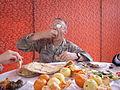 A U.S. officer enjoying the food of Afghanistan - 03132008.jpg