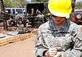 A US Army officer conducting an interview at a school construction site in Honduras.jpg