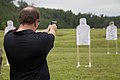 A business leader attending a Marine Corps Executive Forum (MCEF) fires an M9 Beretta pistol at a target aboard Marine Corps Base Quantico, Va., July 11, 2013 130711-M-MI461-355.jpg