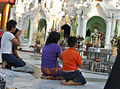 A family at a temple, Buddhist culture religion rites rituals sights.jpg