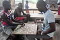 A game of draughts played in Ghana.jpg