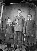 A young woman and two young men NLW3364694.jpg