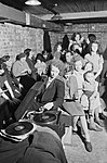 A young woman plays a gramophone in an air raid shelter in north London during 1940. D1631.jpg