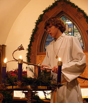 Lighting Advent candles on Christmas Eve at Ca...