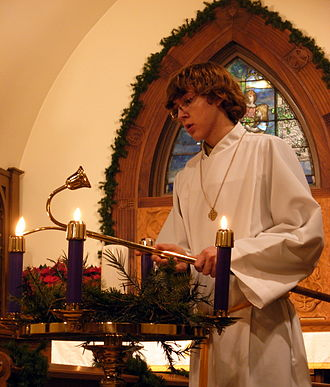 Advent - An acolyte lighting Advent candles