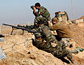 Afghan National Army Soldiers with 1st Kandak, 1st Brigade, 215th Corps, spot and fire on targets using the M-24 sniper rifle with a tactical Leupold scope attachment at a target during a designated marksmanship 120125-M-MA864-178.jpg