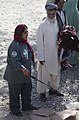 Afghan Uniformed Police officer Noor Haya talks with an elder outside the district center in Spin Boldak, Kandahar province, Afghanistan, Sept 110918-A-VB845-368.jpg