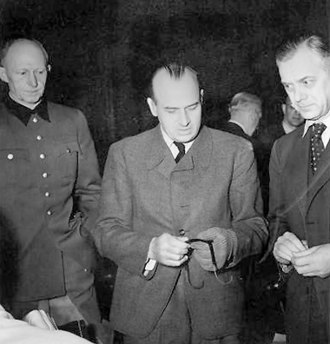 Pabst Plan - Hans Frank (center, wearing a glove after an unsuccessful suicide attempt shortly after his arrest) at the Nuremberg trial, with Alfred Jodl and Alfred Rosenberg
