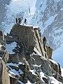 Alpinistes sur un piton de l'Aiguille du Midi.jpg