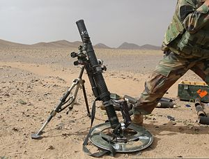 An Afghan National Army commando with the 1st Tolai, 3rd Special Operations Kandak fires a mortar round during a training exercise in the Dand district, Kandahar province, Afghanistan, May 25, 2013 130525-A-QS703-119 (cropped 2).jpg