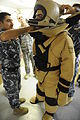 An Iraqi explosive ordnance disposal (EOD) soldier secures the chin strap of an EOD bomb disposal suit helmet during EOD training in the Kirkuk province of Iraq Aug. 28, 2010 100828-A-DM673-167.jpg
