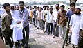 An old man is being taking to polling both to cast his vote at a polling booth under the Tezpur constituency for the 1st phase of Assam Assembly Election, at Tezpur on April 04, 2011.jpg