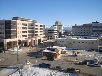 Judiciary of Alaska - The western end of Fourth Avenue in downtown Anchorage.  The Nesbett Courthouse (named in honor of Buell A. Nesbett) is at left.  The administrative offices for the court system are in the smaller building at right foreground, formerly the home of the Anchorage Times newspaper.