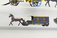 Antique tin toy horse-drawn bus (26149315635).jpg