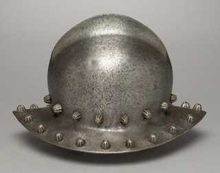 helmet made of steel in the shape of a brimmed hat