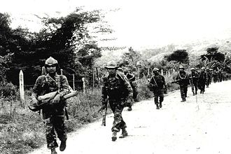 Foreign interventions by the United States - The U.S.-supported Contra rebels marching through Jinotega in 1985