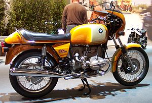 Gold BMW R90S motorcycle in gleaming showroom condition