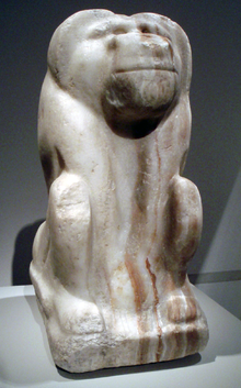 Crude stone statue of a baboon