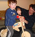 Balance bike adjusted by adult.jpg