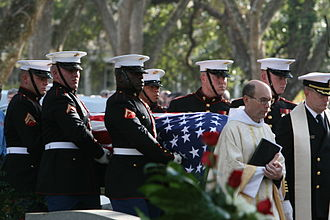 Military funerals in the United States - A military chaplain seen leading honor guards derived from the United States Marine Corps as they carry the casket of General Robert H. Barrow to the place of burial.