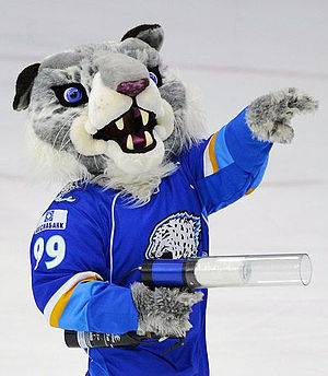 Barys Astana - Barsik throws T-shirts to the fans during the game