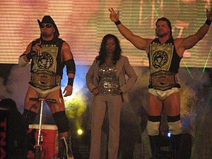 Jacqueline Moore - Moore along Beer Money, Inc. (James Storm and Robert Roode) during an TNA live show in 2008