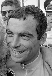 Black-and-white photograph of Hinault's face, smiling