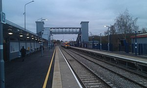Bicester Village railway station - North-east view of the remodelled station with an approaching train