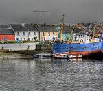 Blue boat by town (8045730460).jpg