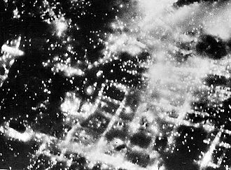 Firestorm - Braunschweig burning after aerial firebombing attack in 1944. Notice that a firestorm event has yet to develop in this picture, as single isolated fires are seen burning, and not the single large mass fire that is the identifying characteristic of a firestorm.