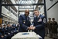 Brig. Gen. Trent Edwards and Chief Master Sgt. Brendan Criswell use the ceremonial sword to cut the Air Force birthday cake (29942752055).jpg