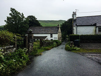 Briggflatts - Looking south down Brigflatts Lane. The Quaker Meeting House is the building on the left.