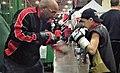 Buddy McGirt and Vito Mielnicki Jr warming up at Arnold Expo.jpg