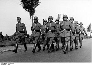 Schutzpolizei (Nazi Germany) - Schutzpolizei in France 1940; marching.