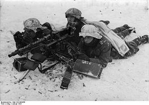 Infantry Regiment Großdeutschland - Soldiers of the Großdeutschland regiment man a heavy MG 34 on a stationary tripod mount