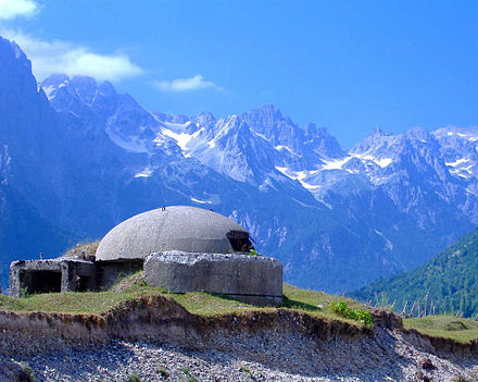 A bunker overlooking the Albanian Alps. By 1983, approximately 173,371 concrete bunkers were scattered across the country.[103]