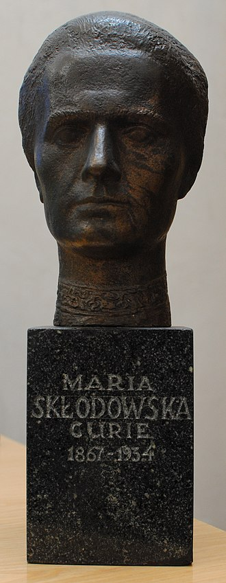 """Polish Chemical Society - Bronze bust of Marie Curie, on green marble stand. Presented by the Polish Chemical Society to the Royal Institute of Chemistry on the latter's centenary in 1977. Now in the Royal Society of Chemistry's HQ at Burlington House, London. Gold lettering on the stand reads """"Maria Skłodowska Curie 1867-1934""""."""