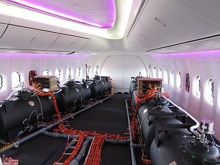 Ballast barrels in a prototype Boeing 747. Photographs of flight test barrels are sometimes said to show chemtrail planes.