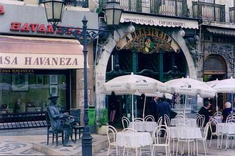 Café A Brasileira - The iconic façade of the Café A Brasileira with the figure of Fernando Pessoa at his usual table