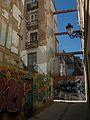Carrer amb graffitis per la Xerea, València.JPG