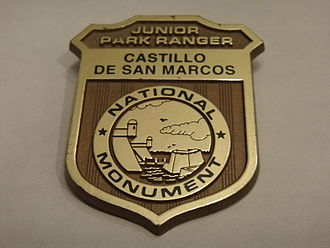 Junior Ranger Program - A Junior Park Ranger badge that was awarded by the Castillo de San Marcos National Monument.
